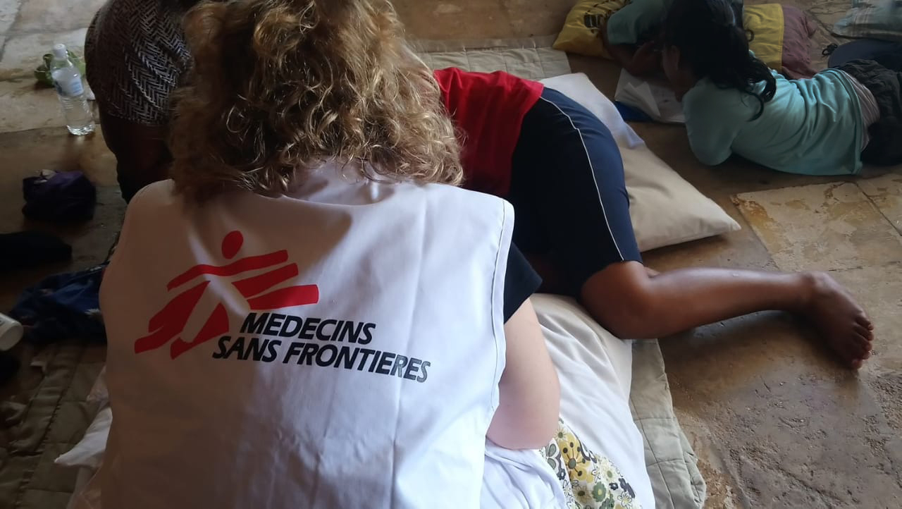 An MSF mental health team member attends to a patient in Nauru