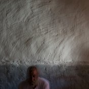 Hassan Khudeda Qasim, 51, poses in his home on Sinjar mountain. © Emilienne Malfatto / MSF