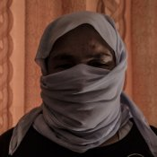 A Yazidi woman aged 60 poses in her house in Sinuni Emilienne Malfatto